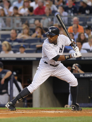 NEW YORK, NY - AUGUST 24:  Curtis Granderson #14 of the New York Yankees against the Oakland Athletics on August 24, 2011 at Yankee Stadium in the Bronx borough of New York City.  (Photo by Nick Laham/Getty Images)