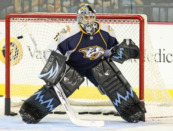 NASHVILLE, TN - SEPTEMBER 17:  Goalie Mark Dekanich #31 of the Nashville Predators skates during an NHL pre-season game at the Sommet Center on September 17, 2009 in Nashville, Tennessee.  (Photo by Frederick Breedon/Getty Images)
