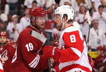 GLENDALE, AZ - APRIL 20:  Shane Doan #19 of the Phoenix Coyotes and Justin Abdelkader #8 of the Detroit Red Wings shake hands following Game Four of the Western Conference Quarterfinals during the 2011 NHL Stanley Cup Playoffs at Jobing.com Arena on April