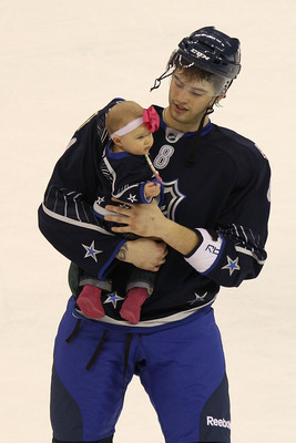 RALEIGH, NC - JANUARY 30:  Brent Burns #8 of the Minnesota Wild and Team Lidstrom holds his daughter Peyton after they defeated Team Staal 11 to 10 in the 58th NHL All-Star Game at RBC Center on January 30, 2011 in Raleigh, North Carolina.  (Photo by Bruc