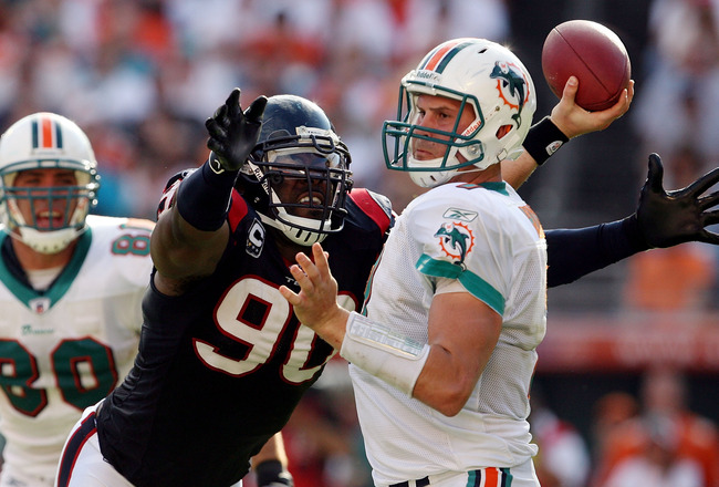MIAMI - DECEMBER 27:  Defensive end Mario Williams #90 of the Houston Texans pressures quarterback Chad Henne #7 of the Miami Dolphins at Land Shark Stadium on December 27, 2009 in Miami, Florida. The Texans defeated the Dolphins 27-20.  (Photo by Doug Be