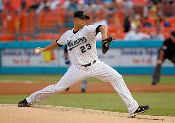 MIAMI GARDENS, FL - SEPTEMBER 05:  Javier Vazquez #23 of the Florida Marlins pitches during a game against the New York Mets at Sun Life Stadium on September 5, 2011 in Miami Gardens, Florida.  (Photo by Mike Ehrmann/Getty Images)