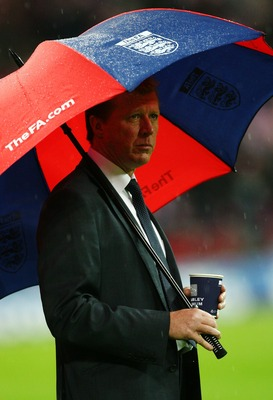 LONDON - NOVEMBER 21:  Steve McClaren manager of England looks on from under his umbrella prior to the Euro 2008 Group E qualifying match between England and Croatia at Wembley Stadium on November 21, 2007 in London, England.  (Photo by Alex Livesey/Getty