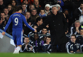 LONDON, ENGLAND - FEBRUARY 06:  Fernando Torres of Chelsea shakes hands with Carlo Ancelotti manager of Chelsea as he is substituted during the Barclays Premier League match between Chelsea and Liverpool at Stamford Bridge on February 6, 2011 in London, E