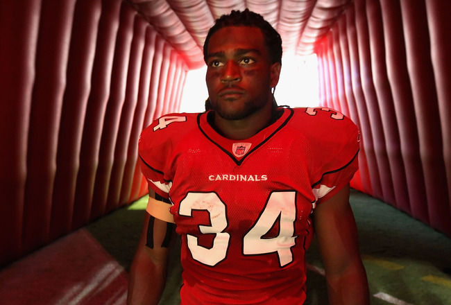 GLENDALE, AZ - SEPTEMBER 26:  Runningback Tim Hightower #34 of the Arizona Cardinals prepares to run out onto the field before the NFL game against the Oakland Raiders at the University of Phoenix Stadium on September 26, 2010 in Glendale, Arizona.  The C