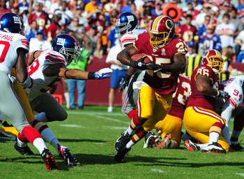 LANDOVER, MD - SEPTEMBER 11: Tim Hightower #25 of the Washington Redskins carries the ball against the New York Giants during the season-opening game at FedEx Field on September 11, 2011 in Landover, Maryland. (Photo by Scott Cunningham/Getty Images)