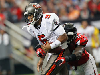 ATLANTA - NOVEMBER 07:  Quarterback Josh Freeman #5 of the Tampa Bay Buccaneers is tackledy by Stephen Nicholas #54 of the Atlanta Falcons at Georgia Dome on November 7, 2010 in Atlanta, Georgia.  (Photo by Kevin C. Cox/Getty Images)