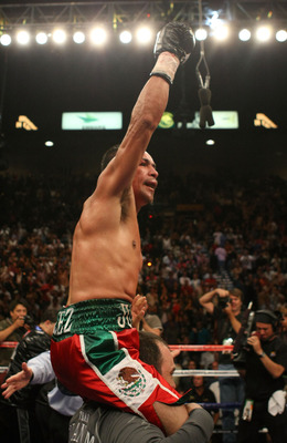 LAS VEGAS - SEPTEMBER 13:  Juan Manuel Marquez celebrates after knocking out Joel Casamayor in the 11th round during their bout at the MGM Grand Garden Arena September 13, 2008 in Las Vegas, Nevada.  (Photo by Jed Jacobsohn/Getty Images)