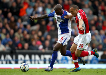 BLACKBURN, ENGLAND - MAY 03:  Jason Roberts of Blackburn Rovers holds off a challenge from Mikael Silvestre of Arsenal during the Barclays Premier League match between Blackburn Rovers and Arsenal at Ewood Park on May 3, 2010 in Blackburn, England.  (Phot