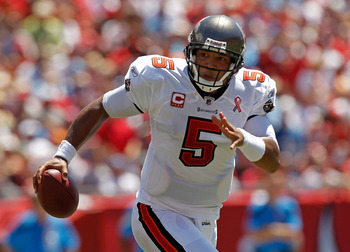 TAMPA, FL - SEPTEMBER 11:  Josh Freeman #5 of the Tampa Bay Buccaneers scrambles during the season opener against the Detroit Lions at Raymond James Stadium on September 11, 2011 in Tampa, Florida.  (Photo by Mike Ehrmann/Getty Images)
