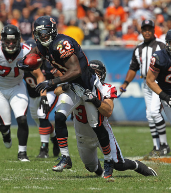 CHICAGO, IL - SEPTEMBER 11: Devin Hester #23 of the Chicago Bears tries to break away from Shann Schillinger #39 of the Atlanta Falcons at Soldier Field on September 11, 2011 in Chicago, Illinois. The Bears defeated the Falcons 30-12. (Photo by Jonathan D