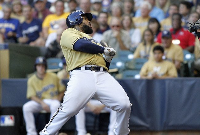 MILWAUKEE, WI - SEPTEMBER 10: Prince Fielder #28  of the Milwaukee Brewers dodges an inside pitch against the Philadelphia Phillies during game action at Miller Park on September 10, 2011 in Milwaukee, Wisconsin. (Photo by Mark Hirsch/Getty Images)