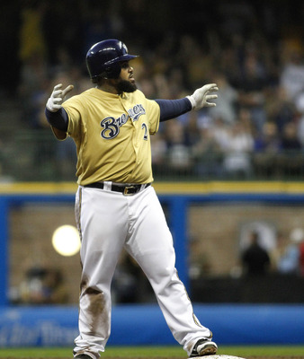 MILWAUKEE, WI - SEPTEMBER 10: Prince Fielder #28 of the Milwaukee Brewers makes monster hands to the crowd during game action against the Philadelphia Phillies at Miller Park on September 10, 2011 in Milwaukee, Wisconsin. The Phillies beat the Brewers  3-