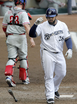 MILWAUKEE, WI - SEPTEMBER 11:  Prince Fielder #28 of the Milwaukee Brewers tosses his bat after striking out in a game against the Philadelphia Phillies at Miller Park on September 11, 2011 in Milwaukee, Wisconsin.The Brewers beat the Phillies 3-2.  (Phot