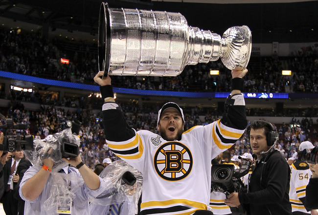 VANCOUVER, BC - JUNE 15:  David Krejci #46 of the Boston Bruins celebrates with the Stanley Cup after defeating the Vancouver Canucks in Game Seven of the 2011 NHL Stanley Cup Final at Rogers Arena on June 15, 2011 in Vancouver, British Columbia, Canada.