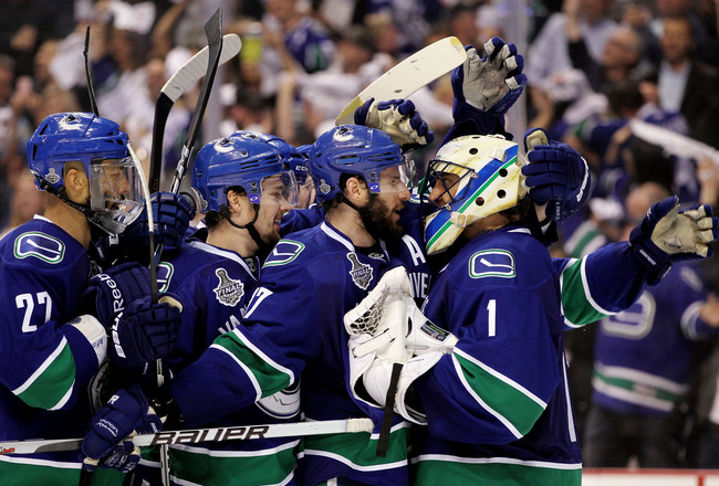 VANCOUVER, BC - JUNE 10:  Roberto Luongo #1 and Ryan Kesler #17 and the Vancouver Canucks celebrate after defeating the Boston Bruins by a score of 1-0 in Game Five of the 2011 NHL Stanley Cup Final at Rogers Arena on June 10, 2011 in Vancouver, British C