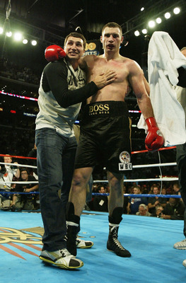 LOS ANGELES, CA - APRIL 24:  Vitali Klitschko (R) celebrates with his brother Wladamir after beating Corrie Sanders by TKO in the eight round and becomes the WBC Heavyweight Champion on April 24, 2004 at Staples Center in Los Angeles, California.  (Photo