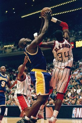 14 Nov 1997:  Center Shaquille O''Neal of the Los Angeles Lakers (left) fights for the ball against center Hakeem Olajuwon of the Houston Rockets during a game at the Compaq Center in Houston, Texas.  The Lakers won the game 113-103 in overtime. Mandatory