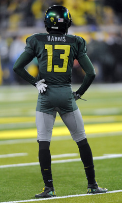 EUGENE, OR - NOVEMBER 26: Cornerback Cliff Harris #13 of the Oregon Ducks waits at the line of scrimmage in the fourth quarter of the game against the Arizona Wildcats at Autzen Stadium on November 26, 2010 in Eugene, Oregon. (Photo by Steve Dykes/Getty I