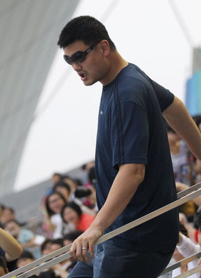 SHANGHAI, CHINA - JULY 23:  Former NBA basketball player Yao Ming attends the Women's 3m Springboard Final during Day Eight of the 14th FINA World Championships at the Oriental Sports Center on July 23, 2011 in Shanghai, China.  (Photo by Feng Li/Getty Im