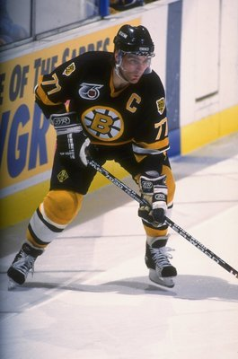 Defenseman Ray Bourque of the Boston Bruins works against the Buffalo Sabres during a game at Memorial Auditorium in Buffalo, New York.