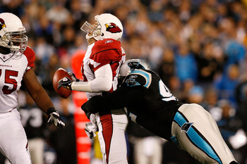 CHARLOTTE, NC - JANUARY 10:  Damione Lewis #92 of the Carolina Panthers sacks Kurt Warner #13 of the Arizona Cardinals during the NFC Divisional Playoff Game on January 10, 2009 at Bank of America Stadium in Charlotte, North Carolina.  (Photo by Kevin C.