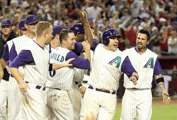 PHOENIX, AZ - SEPTEMBER 10:  (L-R) Daniel Hudson #41, Aaron Hill #2, John McDonald #16, Miguel Montero #26 and Ryan Roberts #14 of the Arizona Diamondbacks celebrates after a walk off win against the San Diego Padres in the tenth inning of the Major Leagu