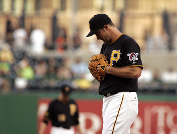PITTSBURGH, PA - AUGUST 23:  Ross Ohlendorf #49 of the Pittsburgh Pirates reacts after giving up seven runs in two innings against the Milwaukee Brewers during the game on August 23, 2011 at PNC Park in Pittsburgh, Pennsylvania.  (Photo by Justin K. Aller