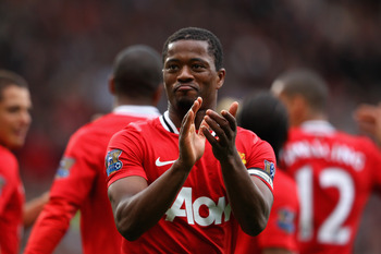 MANCHESTER, ENGLAND - AUGUST 28:  Patrice Evra of Manchester United celebrates after team mate Nani scores their side's fifth goal during the Barclays Premier League match between Manchester United and Arsenal at Old Trafford on August 28, 2011 in Manches