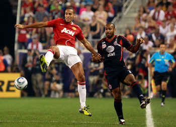 HARRISON, NJ - JULY 27:  Rio Ferdinand #5 of the Manchester United battles for the ball against Thierry Henry #14 of the MLS All-Stars during the first half of the MLS All-Star Game at Red Bull Arena on July 27, 2011 in Harrison, New Jersey.  (Photo by Ch
