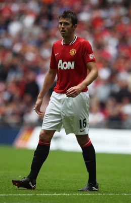LONDON, ENGLAND - AUGUST 07:  Michael Carrick of Manchester United looks on during the FA Community Shield match sponsored by McDonald's between Manchester City and Manchester United at Wembley Stadium on August 7, 2011 in London, England.  (Photo by Cliv