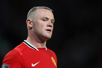 MANCHESTER, ENGLAND - AUGUST 22:  Wayne Rooney of Manchester United looks on during the Barclays Premier League match between Manchester United and Tottenham Hotspur at Old Trafford on August 22, 2011 in Manchester, England.  (Photo by Alex Livesey/Getty