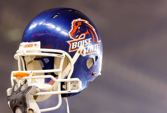GLENDALE, AZ - JANUARY 01: A Boise State Broncos player holds up his helmet against the Oklahoma Sooners at the Tostito's Fiesta Bowl at University of Phoenix Stadium on January 1, 2007 in Glendale, Arizona. The Broncos defeated the Sooners 43-42 in overt