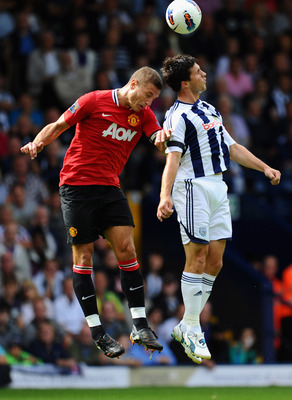 WEST BROMWICH, ENGLAND - AUGUST 14: Nemanja Vidic of Manchester United jumps for a header with Shane Long of West Bromwich Albion during the Barclays Premier League match between West Bromwich Albion and Manchester United at The Hawthorns on August 14, 20