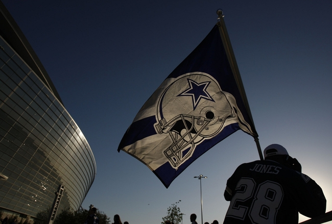 ARLINGTON, TX - SEPTEMBER 28: A fan holds a Dallas Cowboys flag outside of Cowboys Stadium prior to their game against the Carolina Panthers on September 28, 2009 in Arlington, Texas. (Photo by Ronald Martinez/Getty Images)