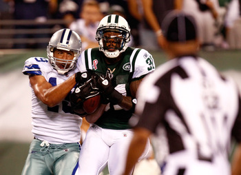 EAST RUTHERFORD, NJ - SEPTEMBER 11:  Miles Austin #19 of the Dallas Cowboys catches a 36-yard touchdown in the third quarter against Antonio Cromartie #31 of the New York Jets during their NFL Season Opening Game at MetLife Stadium on September 11, 2011 i
