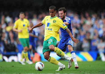 LONDON, ENGLAND - AUGUST 27:  Juan Mata of Chelsea closes down Kyle Naughton of Norwich City during the Barclays Premier League match between Chelsea and Norwich City at Stamford Bridge on August 27, 2011 in London, England.  (Photo by Shaun Botterill/Get