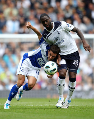 LONDON, ENGLAND - MAY 22: Matt Derbyshire of Birmingham City is challenged by Ledley King of Tottenham Hotspur during the Barclays Premier League match between Tottenham Hotspur and Birmingham City at White Hart Lane on May 22, 2011 in London, England.  (