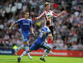 SUNDERLAND, ENGLAND - SEPTEMBER 10:  Nicklas Bendtner of Sunderland competes with John Terry and Raul Meireles of Chelsea during the Barclays Premier League match between Sunderland and Chelsea at the Stadium of Light on September 10, 2011 in Sunderland,