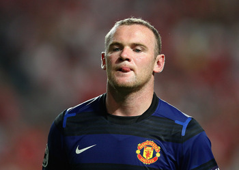 LISBON, PORTUGAL - SEPTEMBER 14:  Wayne Rooney of Manchester United in action during the UEFA Champions League Group C match between SL Benfica and Manchester United at the Estadio da Luz on September 14, 2011 in Lisbon, Portugal.  (Photo by Clive Mason/G