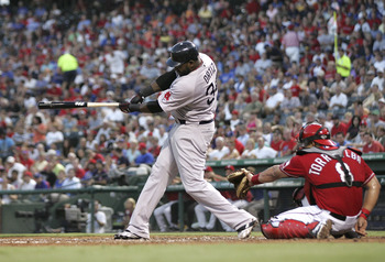 ARLINGTON, TX - AUGUST 25: David Ortiz #34 of the Boston Red Sox makes a base hit against the Texas Rangers during the game at Rangers Ballpark in Arlington on August 25, 2011 in Arlington, Texas. (Photo by Rick Yeatts/Getty Images)