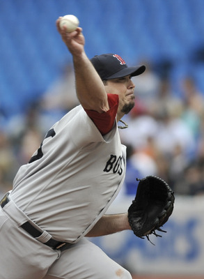 TORONTO, CANADA - SEPTEMBER 05:  Josh Beckett #19 of the Boston Red Sox delivers a pitch during MLB game action against the Toronto Blue Jays September 5, 2011 at Rogers Centre in Toronto, Ontario, Canada. (Photo by Brad White/Getty Images)