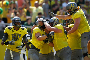 EUGENE, OR - SEPTEMBER 10:  Colt Lyeria #32 of the Oregon Ducks celebrates with teammates after scoring a touchdown against the Nevada Wolf Pack on September 10, 2011 at the Autzen Stadium in Eugene, Oregon.  (Photo by Jonathan Ferrey/Getty Images)