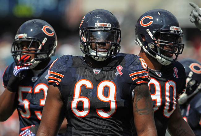 CHICAGO, IL - SEPTEMBER 11: (L-R) Nick Roach #53, Henry Melton #69 and Julius Peppers #90 of the Chicago Bears await the start of play against the Atlanta Falcons at Soldier Field on September 11, 2011 in Chicago, Illinois. The Bears defeated the Falcons