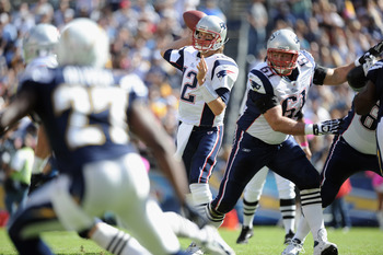 SAN DIEGO - OCTOBER 24:  Tom Brady #12 of the  New England Patriots passes in the pocket with the block of Stephen Neal #61 against the San Diego Chargers during the first quarter at Qualcomm Stadium on October 24, 2010 in San Diego, California.  (Photo b