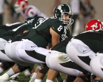 EAST LANSING, MI - SEPTEMBER 02:  Quarterback Kirk Cousins #8 of the Michigan State Spartans gets set for the snap during an NCAA football game against the Youngstown State Penguins at Spartan Stadium on September 2, 2011 in East Lansing, Michigan.  (Phot