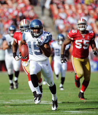 SAN FRANCISCO, CA - SEPTEMBER 11: Doug Baldwin #15 of the Seattle Seahawks runs away from the 49ers defense for a 55 yard touchdown catch and run in the fourth quarter of an NFL football game at Candlestick Park on September 11, 2011 in San Francisco, Cal