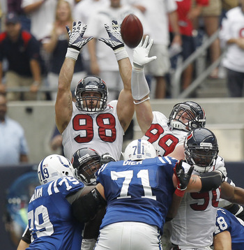 HOUSTON - SEPTEMBER 11:  Connor Barwin #98 and J.J. Watt #99 of the Houston Texans attempt to block the field goal attempt by kicker Adam Vinatieri of the Indianapolis Colts during the season-opening game at Reliant Stadium on September 11, 2011 in Housto