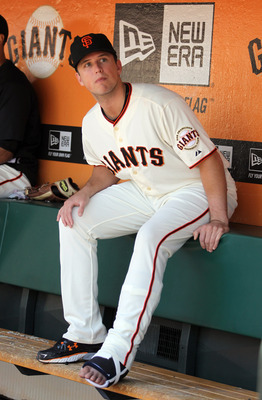 SAN FRANCISCO, CA - JUNE 23:  Injured Buster Posey #28 of the San Francisco Giants sits in the dugout during their game against the Minnesota Twins at AT&T Park on June 23, 2011 in San Francisco, California.  (Photo by Ezra Shaw/Getty Images)