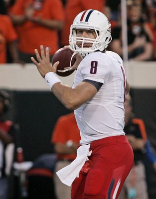 STILLWATER, OK - SEPTEMBER 8:  Quarterback Nick Foles #8 of the Arizona Wildcats looks to throw during the first half against the Oklahoma State Cowboys on September 8, 2011 at Boone Pickens Stadium in Stillwater, Oklahoma.  Oklahoma State defeated Arizon